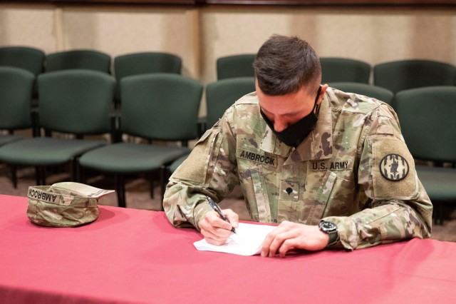 FORT CARSON, Colo. – Spc. Nicholas C. Ambrocik, a military police soldier assigned to 759th Military Police Battalion takes a written exam during the Best Warrior Competition at 4th Infantry Division headquarters, Fort Carson, Colorado May 13, 2020. Ambrocik would go on to win the Best Warrior Competition in the lower enlisted category and will participate in the III Corps Best Warrior Competition later this year at Fort Hood, Texas. (U.S. Army photo by Staff Sgt. Scott J. Evans, 4th Infantry Division Public Affairs Office)