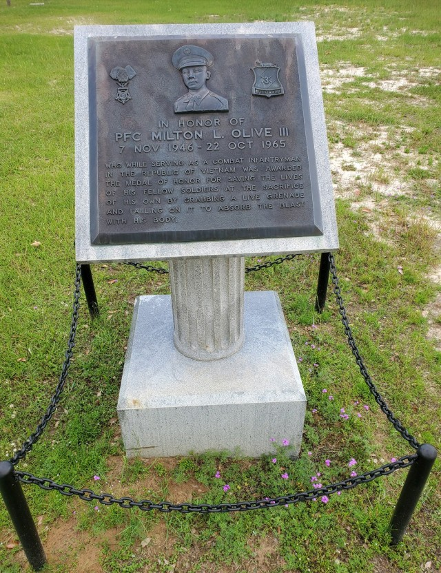 An Honor Field memorial for Pfc. Milton L. Olive III who absorbed the shock of a live grenade, giving his life, to save the lives of his fellow Soldiers while serving in Vietnam.