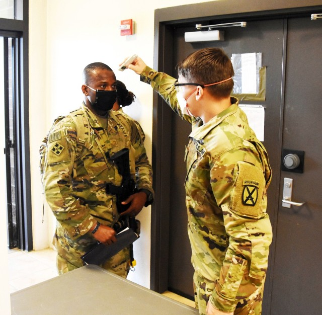 A 4th SFAB Soldier undergoes a temperature scan while following COVID-19 mitigation measures.