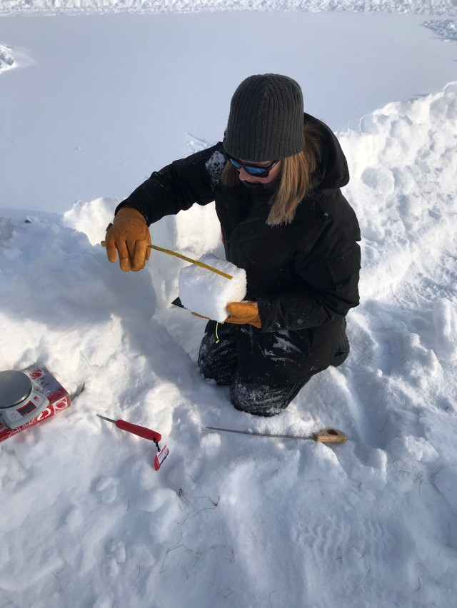 Amelia Menke, engineer with the U.S. Army Corps of Engineers - Cold Regions Research and Engineering Laboratory, measures and weighs snow to determine its density. The relatively dry snow in Fairbanks is much drier due to the extreme cold than the snow used in a previous evaluation conducted in Vermont.