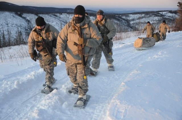 Members of 1st Battalion, 297th Infantry Regiment based in Joint Base Elmendorf-Richardson, Alaska, and part of the Alaska National Guard, pull an Ahkio sled through the Yukon Training area Feb. 28, on Eielson Air force Base as part of exercise Arctic Eagle 2020.