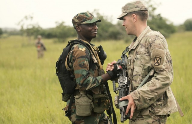 A Soldier with the Ghana Armed Forces and a Soldier with U.S. Army's 1-32 Infantry Regiment, 1st Brigade Combat Team, 10th Mountain Division greet each other during a field training exercise as part of United Accord 2018 at the Bundase Training Camp. More than 800 military personnel participated in UA18, which is one of the exercises that promotes interoperability between the U.S. and partner forces and organizations.