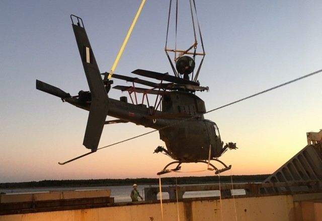 Loading of one of the six flyable aircraft into the transport ship at the port in Jacksonville, Florida. (Photo by John Zimmerman, Army Futures Command)