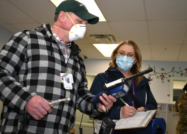 FORT DRUM, N.Y. – Bart Bushen (left) and Julie Shoemaker (right), both industrial hygienists with the Fort Drum Medical Activity, conduct a detailed air quality survey of the Po Valley Child Development Center on Fort Drum April 30, 2020. The Po Valley CDC had been closed due to COVID-19, and the industrial hygiene team conducted the air quality testing to ensure the center was safe to reopen. (U.S. Army photo by Warren W. Wright Jr., Fort Drum Medical Activity Public Affairs)
