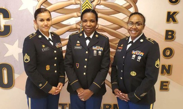 Staff Sgt. Kathlyn Stewart, center, was named the 2020 Army Contracting Command Best Warrior Competition second runner-up May 13, qualifying her to advance to the Army Materiel Command competition in July. Stewart is a contract specialist with the 900th Contracting Battalion at Fort Bragg, North Carolina.