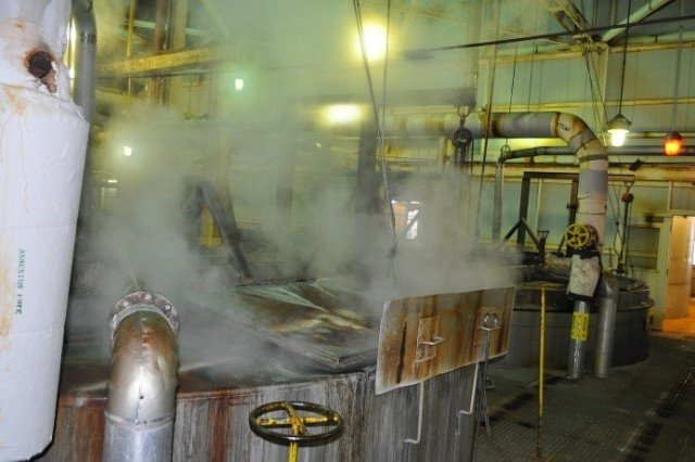 Steam releasing from an open-air boiling tub.