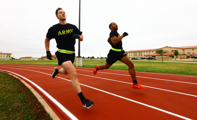 Sgt. Thomas Massengill, A Battery, 1st Battalion, 30th Field Artillery, and a teammate run 800 meters during the Cornerstone Fitness Challenge May 21, 2020, at 1st Battalion, 78th Field Artillery's Teamwork Field.