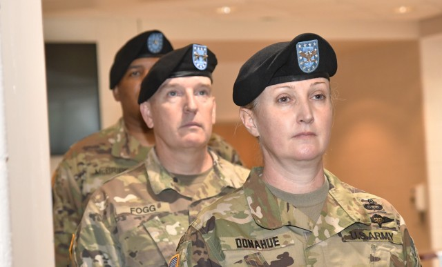 Col. Michelle K. Donahue, incomning Quartermaster General, awaits the announcement for the arrival of the official party along with Maj. Gen. Rodney D. Fogg, CASCOM and Fort Lee commanding general, and Brig. Gen. Douglas M. McBride Jr., during the Quartermaster School Change of Command Ceremony May 29 at Guest Auditorium.