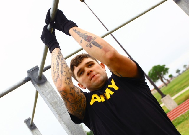Spc. Dylan Crawford performs leg tucks during the Cornerstone Fitness challenge May 21, 2020, at Fort Sill. He would  go on to take 3rd-place overall.
