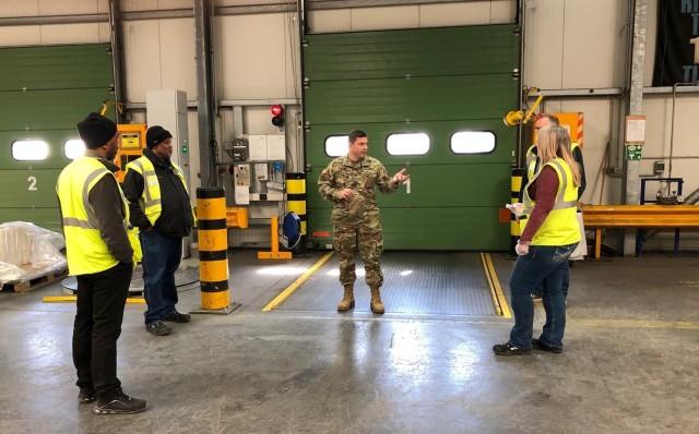 U.S. Army Garrison Rheinland-Pfalz Commander Col. Jason T. Edwards visits a Defense Commissary Agency (DeCA) warehouse and speaks with DeCA representatives April 1 at Germersheim Army Depot.