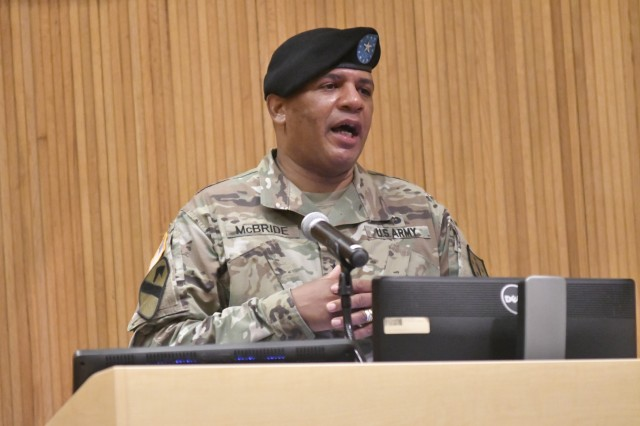 Brig. Gen. Douglas M. McBride Jr., departing Quartermaster General, speaks to the audience – live and online – during the Quartermaster School Change of Command Ceremony May 29 at Guest Auditorium. McBride concluded a 31-year career.