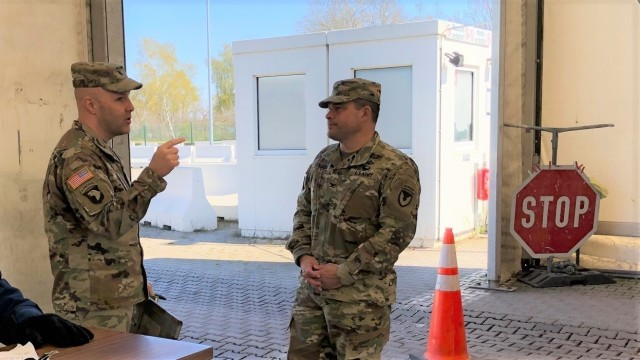 U.S. Army Garrison Rheinland-Pfalz Commander Col. Jason T. Edwards and Lt. Col. Jonathan Ackiss, Commander of Defense Logistics Agency Distribution Europe, discuss entry control and screening operations at one of the Germersheim Army Depot gates April 1.