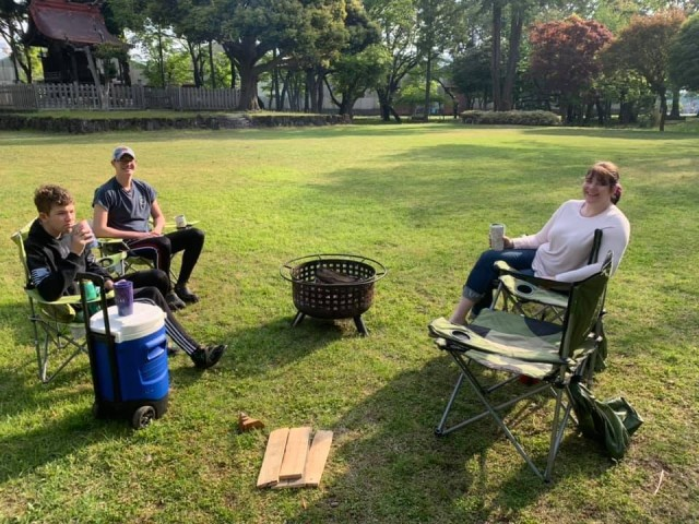 Members of the Matelski family relax next to the shrine in Shrine Park during a camping trip at Sagami General Depot, Japan, during Memorial Day weekend in May. Photo by Col. Thomas Matelski, U.S. Army Garrison Japan