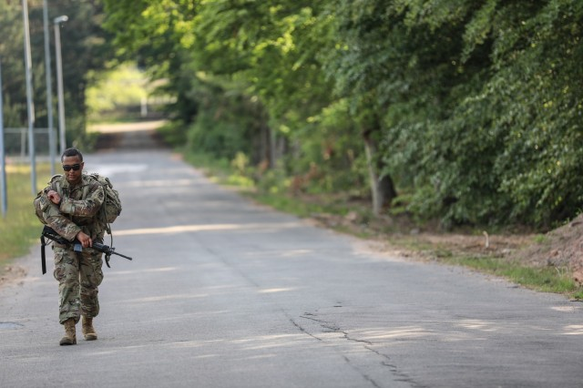 RHINE ORDNANCE BARRACKS, Germany - Staff Sgt. Ian Ledesma, a patriot section chief assigned to Alpha Battery, 5th Battalion, 7th Air Defense Artillery Regiment finishes up the unknown distance foot march on Rhine Ordnance Barracks June 3. Ledesma won the noncommissioned officer category of the European Best Defender Competition and was awarded the Army Commendation Medal for demonstrating professionalism, tactical proficiency, mental and physical toughness.