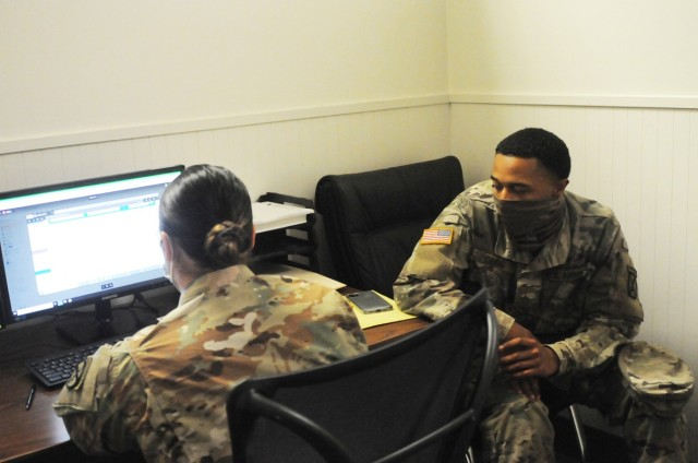 Spc. Paige Barnnett, 317th Brigade Engineer Battalion, 3rd Brigade Combat Team, 10th Mountain Division, a tax specialist at the Fort Polk Installation Tax Center, helps Pvt. Brandon Grigg, 2nd Battalion, 4th Infantry Regiment, 3rd Brigade Combat Team, 10th Mountain Division, get his taxes done June 1.