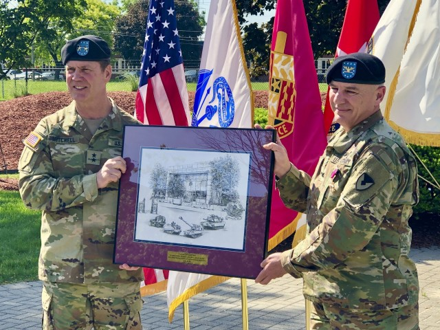 Maj. Gen. Dan Mitchell (left), commanding general Tank-automotive and Armaments Command, presents Col. Jeffrey Witt, TACOM Chief of Staff, with a small gift during his the colonel's retirement ceremony at the Detroit Arsenal June 5.