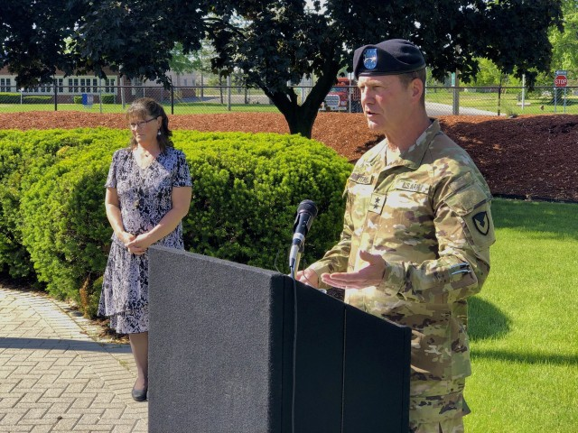Maj. Gen. Dan Mitchell (right), commanding general Tank-automotive and Armaments Command, hosted a retirement ceremony for his Chief of Staff, Col. Jeffrey Witt (not pictured) as the Deputy Chief of Staff, Annette Riggs, looks on.  The ceremony took place at the Detroit Arsenal flag pole June 5.