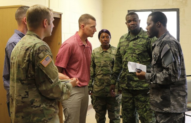 Lt. Col. Michael Berriman, center, commander of 3rd Squadron, 1st Security Force Assistance Brigade, meets with a simulated foreign partner during a mission readiness training exercise at Fort Benning, Ga., Aug. 5, 2019. The mission readiness exercise helped prepare 3rd Squadron for future advising missions anywhere in the world to include Colombia.