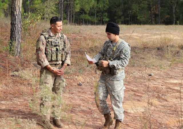 Sgt. 1st Class Jeremiah Velez, left, an advisor with 3rd Squadron, 1st Security Force Assistance Brigade, works with a simulated foreign partner during a field training exercise in October 2019 at Fort Benning, Ga. The exercise helped prepare 3rd Squadron for future advising missions anywhere in the world to include Colombia.