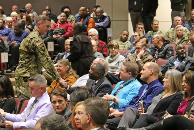 Maj. Gen. Todd Royar, commanding general of the U.S. Army Aviation and Missile Command, greets employees during a Nov. 18, 2019 Town Hall meeting.