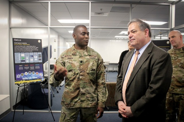 Lt. Col. Peter Amara from Defensive Cyber Operations (DCO) discusses with Jeffrey White, Principal Deputy Assistant Secretary of the Army for Acquisition, Logistics and Technology our rapid acquisition success with the Army's Big Data Platform, Gabriel Nimbus. (Photo by Jennifer Sevier)