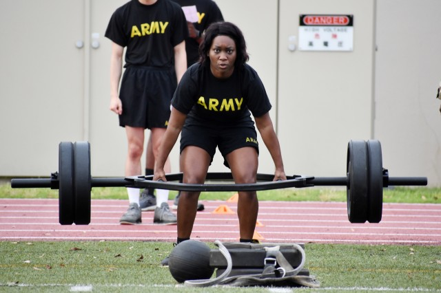 Staff Sgt. Sharonica White, assigned to U.S. Army Garrison Japan, completes a deadlift repetition during the U.S. Army Japan 2020 Army Week's Army Combat Fitness Test Fitness Warrior Competition at Camp Zama, Japan, June 8.