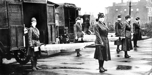 St. Louis Red Cross Motor Corps workers on duty during the influenza epidemic, Oct 1918.