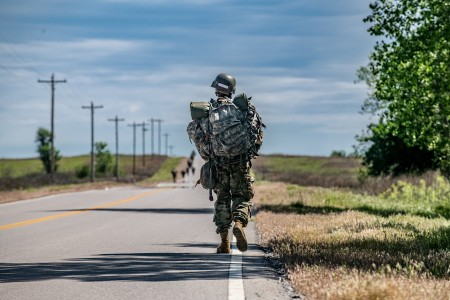 Soldiers conduct a foot march to a weapons qualification range May 6, 2020, on Fort Sill, Okla.