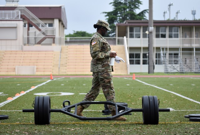 A Soldier cleans off equipment as a COVD-19 precaution during the U.S. Army Japan 2020 Army Week's Army Combat Fitness Test Fitness Warrior Competition at Camp Zama, Japan, June 8.