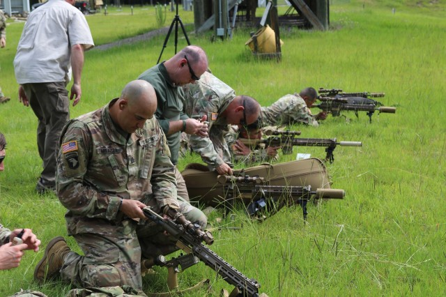 Soldiers from the 1st Armored Brigade Combat Team, 3rd Infantry Division, conduct weapons maintenance at the Fort Stewart, Ga., sniper range while fielding the U.S. Army's new M110A1 Squad Designated Marksman Rifle, June 5th, 2020. 1ABCT was the first unit in the U.S. Army to field this rifle. The SDMR was designed to fill the capability gap between the standard issue rifle, and a sniper rifle.