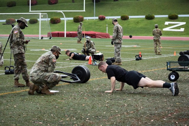 Soldiers do hand-release pushups while competing in the U.S. Army Japan 2020 Army Week's Army Combat Fitness Test Fitness Warrior Competition at Camp Zama, Japan, June 8.