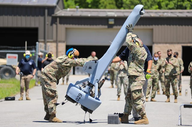 Soldiers from 2nd Brigade Combat Team, 101st Airborne Division (Air Assault), test the Martin UAV V-BAT drone at Fort Campbell, Ky., June 1, 2020. The Army selected five brigades to test four prototypes that can take off and land vertically like a helicopter, as part of the Army Futures Command's Future Unmanned Aircraft Systems effort.