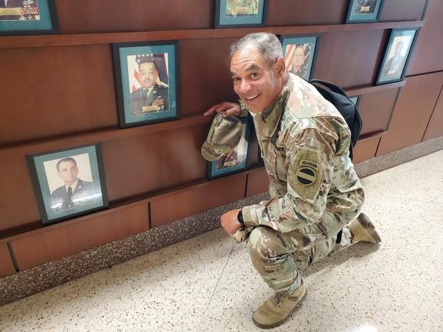 Gen. Michael X. Garrett, FORSCOM Commanding General, with his father's command photo at Fort Stewart, Ga.