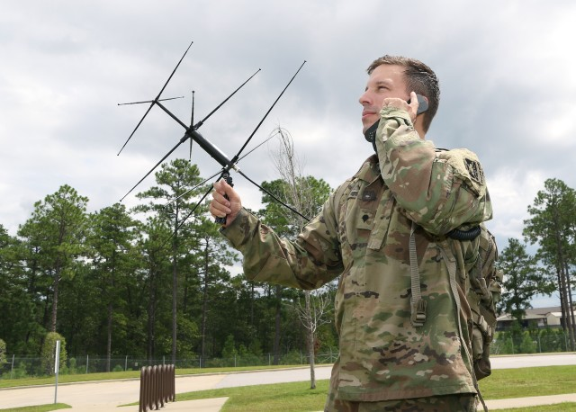 A student assigned to the U.S. Army John F. Kennedy Special Warfare Center and School, who is in the Special Forces Communications Sergeant course, uses an AV-2125 satellite antenna with an AN/PRC-117G satellite radio during training at the Yarborough Training Complex at Fort Bragg, North Carolina August 29, 2019.  A next-generation cellular network technology, network slicing will improve the versatility and flexibility of tactical networks and gain an advantage during multi-domain operations.