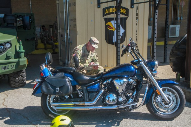 Staff Sergeant Daniel Cameron, 1st Brigade Combat Team's Motorcycle Safety Mentor, recently conducts a motorcycle safety check.