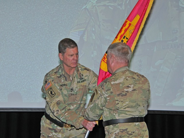 Maj. Gen. Dan Mitchell (left), outgoing commanding general Tank-automotive and Armaments Command, relinquishes command to Maj. Gen. Brian Cummings, Program Executive Officer Ground Combat Systems, who was standing in for Gen. Gus Perna during a virtual change of command June 12 at the Detroit Arsenal, Michigan.