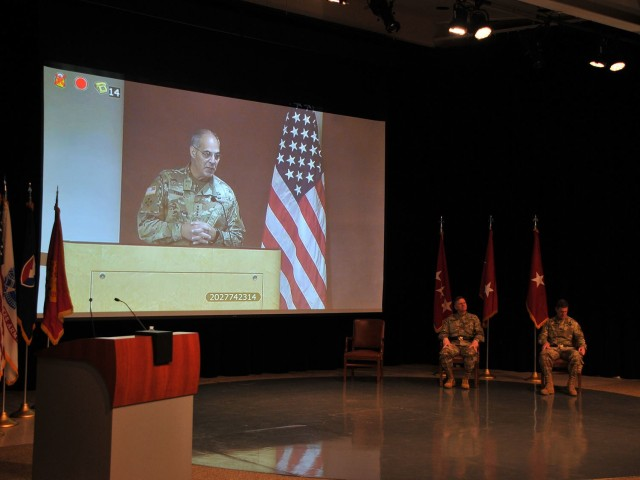 Gen. Gus Perna, commanding general Army Materiel Command, addresses the small crowd during a virtual change of command June 12 at the Detroit Arsenal, Michigan.  Brig. Gen. Darren Werner (seated left) assumed command of Tank-automotive and Armaments Command from Maj. Gen. Dan Mitchell (seated right).