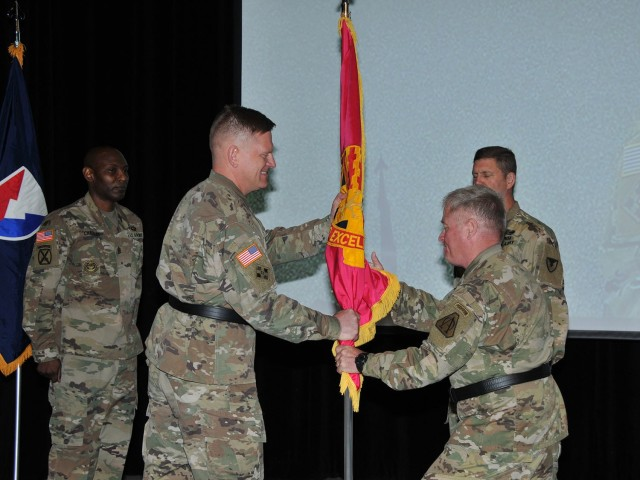 Brig. Gen. Darren Werner (left center), incoming commanding general Tank-automotive and Armaments Command, takes the unit colors from Maj. Gen. Brian Cummings, Program Executive Officer Ground Combat Systems (right center), who was standing in for Gen. Gus Perna, commanding general Army Materiel Command June 12 during a virtual change of command ceremony at the Detroit Arsenal, Michigan.