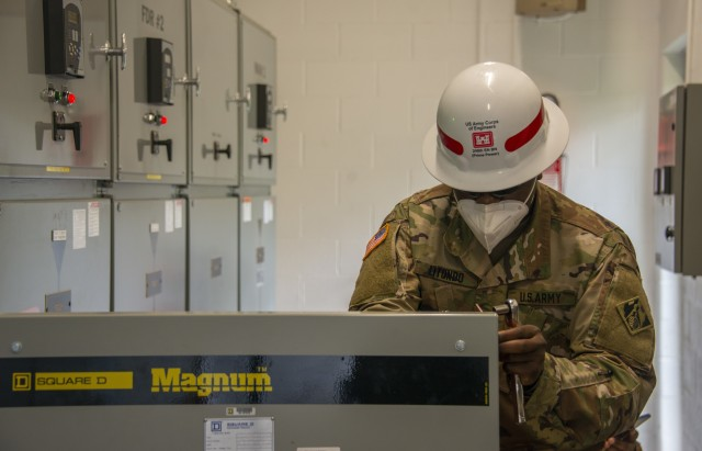 Sgt. Raymond Litondo, Prime Power Specialist with 249th Engineer Battalion, prepares a medium voltage circuit breaker for testing during a CBRM mission at the VA Medical Center in Beckley, WV. The CBRM operations includes testing of the Beckley VA's main electrical vaults which consist of six medium vacuum circuit breakers and associated relays form the primary utility feeds, three main substations and associated circuit breakers, and the substation transformers.