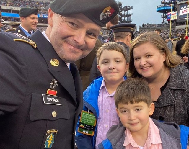 Staff Sgt. Ronald Shurer II, a former 3rd Special Forces Group (Airborne) medic and Medal Of Honor recipient,  takes a quick photo with his wife Miranda, and two kids, Cameron and Tyler, while attending the Army-Navy game at Lincoln Financial Field in Philidelphia, Pennsylvania, Dec. 14, 2019.