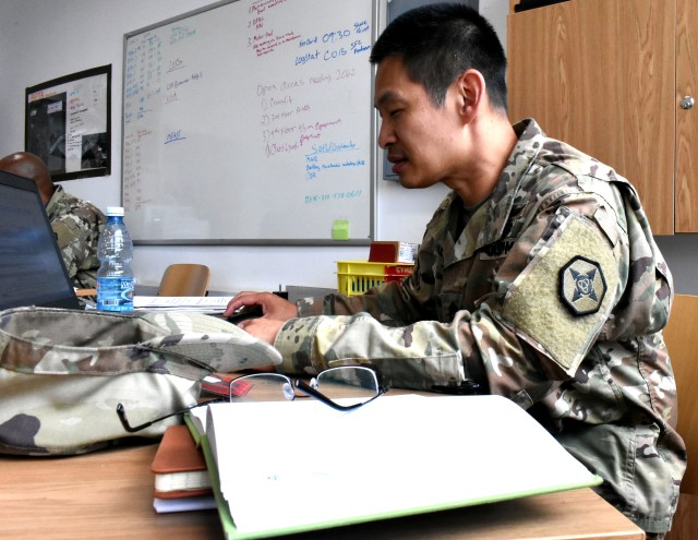 Sgt. 1st Class Than Munzke, a psychological operation senior non commissioned officer from Lakewood, Colorado is reviewing a letter of justification.  Munzke serves as a contracting officer representative at Bemowo Piskie Training Area in Bemowo Piskie, Poland.  BPTA is a NATO base located in the eastern part of Poland.  652nd Regional Support Group, a U.S. Army Reserve Unit out of Helena, Montana, is the first U.S. Army Reserve unit tasked with providing base operations for 11 base camps in Poland.  Base support includes taking care of lodging, dining, and recreational needs of the tenant Soldiers assigned to that base.