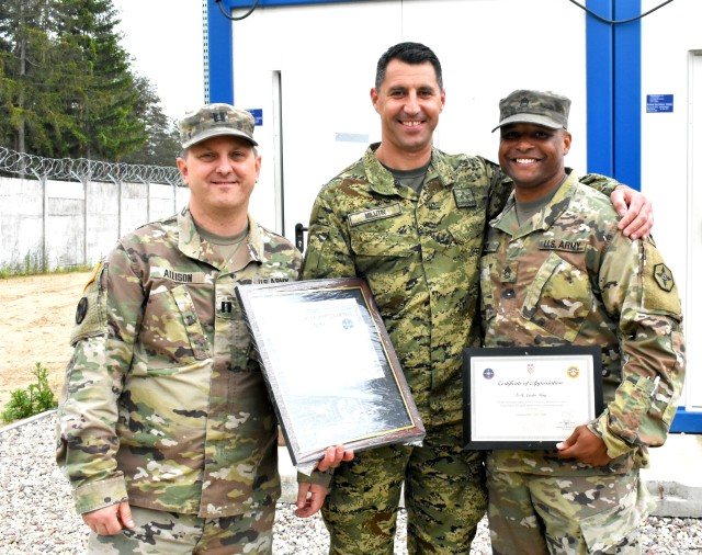 Capt. Craig Allison, a logistics officer from Caldwell, Idaho and Sgt. 1st Class Curtis Ray, a food service senior non commissioned officer from Colorado Springs, Colorado recognized and were recognized by the representative from Croatian Army, Capt. Frane Milutin. Milutin served as one of the base logistics officers on Bemowo Piskie Training Area in Bemowo Piskie, Poland. Working together with NATO allies makes one strong Europe.