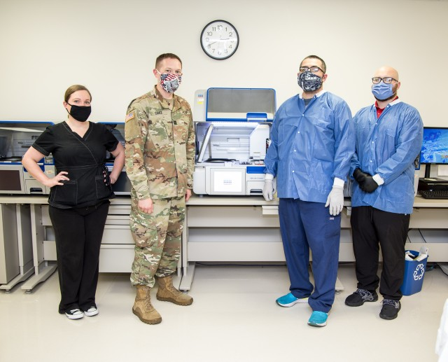 Molecular team members demonstrate molecular ribonucleic acid extraction equipment at Brooke Army Medical Center, Fort Sam Houston, Texas, June 1, 2020. BAMC is actively paving the way for patients to know whether or not they have the virus in a timely manner. (U.S. Army photo by Senior Master Sgt. Sarah Hanaway)
