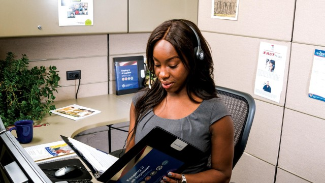 A Military OneSource call center employee reviews one of the many resources available to support service members and their Families.