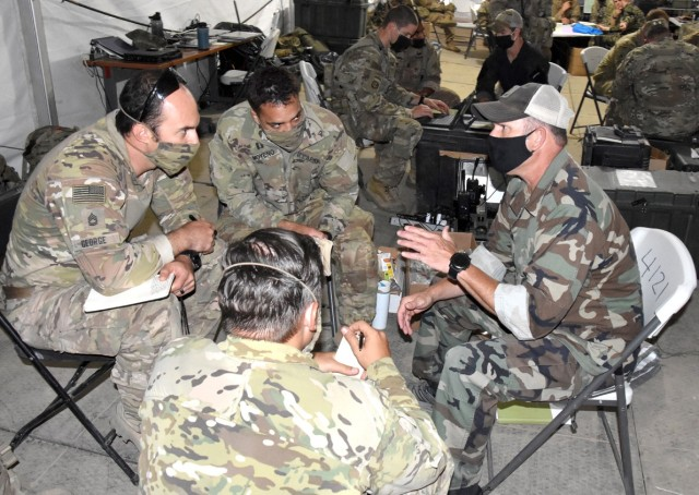 Team leaders with B Co, 1st Bn, 4th SFAB, conduct a key leader engagement exercise with a role player representing a brigade commander in the Afghan army June 17.