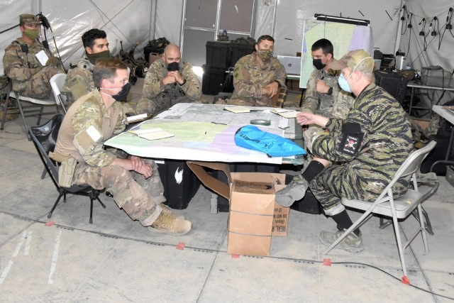 Soldiers with Bravo Company, 1st Battalion, 4th Security Force Assistance Brigade, conduct a key leader engagement June 17 with a role player representing an Afghan army  corps commander.