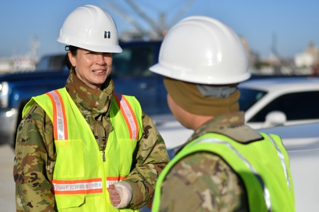 Capt. Jennifer Meier, 842nd Transportation Battalion, and Sgt. James Cordell, 1st Battalion, 6th Infantry Regiment, 2nd Armored Brigade Combat Team, 1st Armored Division discuss a stow plan for the M/V Resolve at the Port of Beaumont, bound for Germany in support of DEFENDER-Europe 20 Feb. 21, 2020.