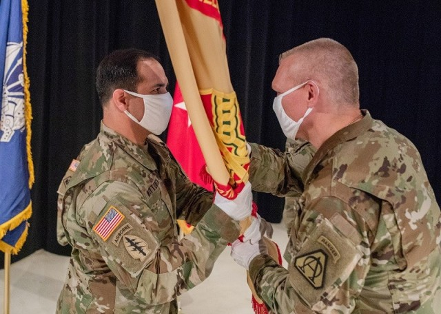 Brig. Gen. Vincent F. Malone II, Picatinny Arsenal commanding general (right), passes the garrison guidon to the incoming garrison commander, Lt. Col. Adam Woytowich.