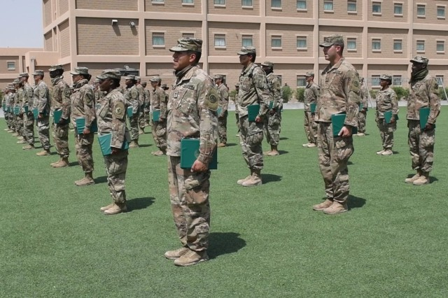 U.S. Army Soldiers from across the Central Command Area of Responsibility stand at their graduation from the Emergency Basic Leaders Course in Kuwait, on June 9, 2020. The EBLC course was offered to Soldiers while they were deployed to the Middle East.