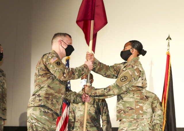 Col. Michael Weber, commander, Landstuhl Regional Medical Center, receives the unit guidon from Col. Stacy Freeman, outgoing commander, Wiesbaden Army Health Clinic, during a change of command and responsibility ceremony, June 12.